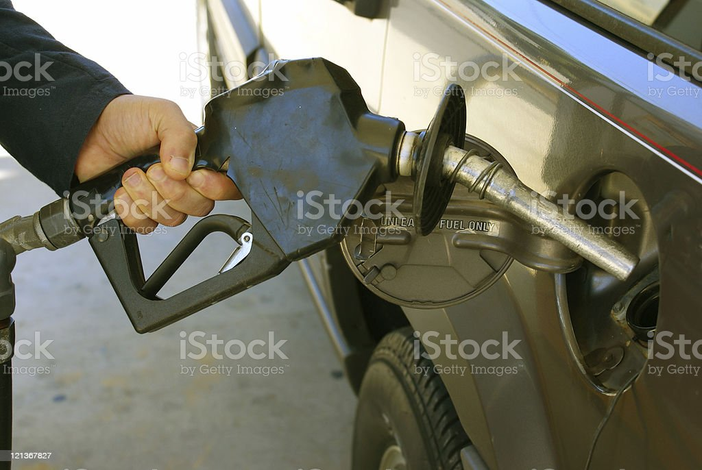 Adding Fuel royalty-free stock photo