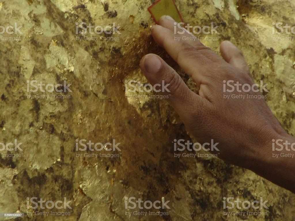 Adding Gold Leaf to Golen Rock, Myanmar stock photo