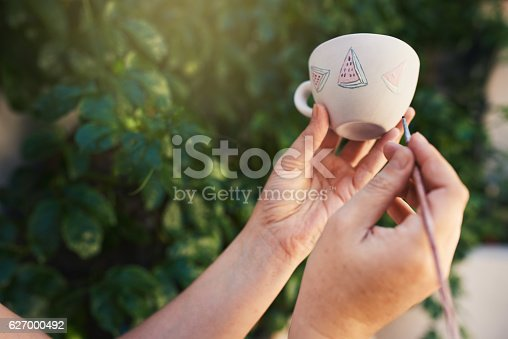 627000458istockphoto Adding her personal touch 627000492