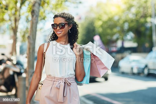 Shot of an attractive young woman going shopping in the city