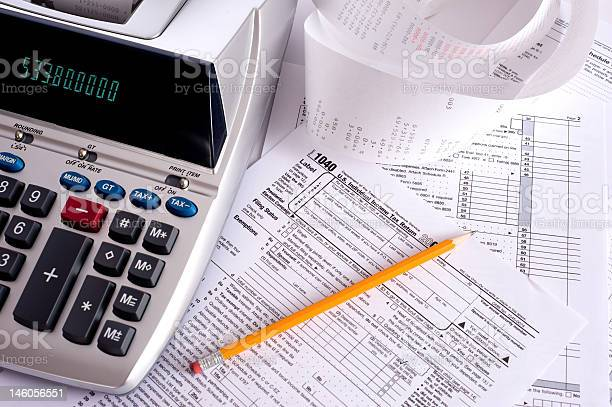 Adding machine with tax forms picture id146056551?b=1&k=6&m=146056551&s=612x612&h=e oghpr4pvqla niyje4h6hwwnaez eyd7tnnbyuo3u=
