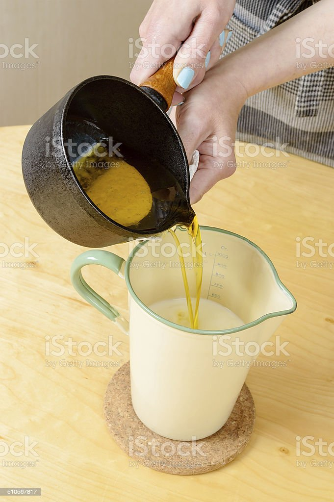Adding melted butter stock photo