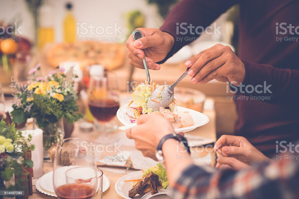 Adding salad stock photo