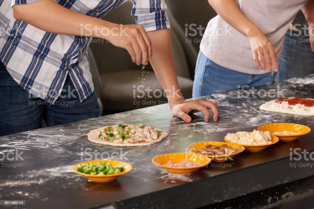 Ajouter un peu de fromage râpé - Photo