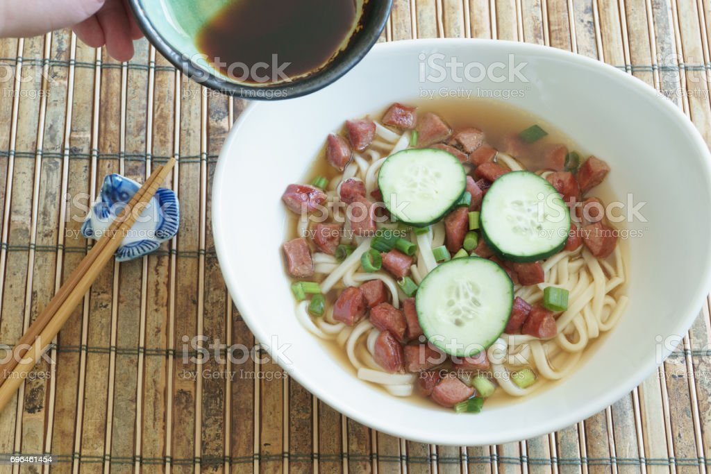 Adding Soy Sauce to Udon Noodles stock photo
