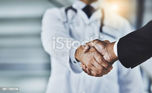 istock Adding the corporate factor to healthcare 991799206