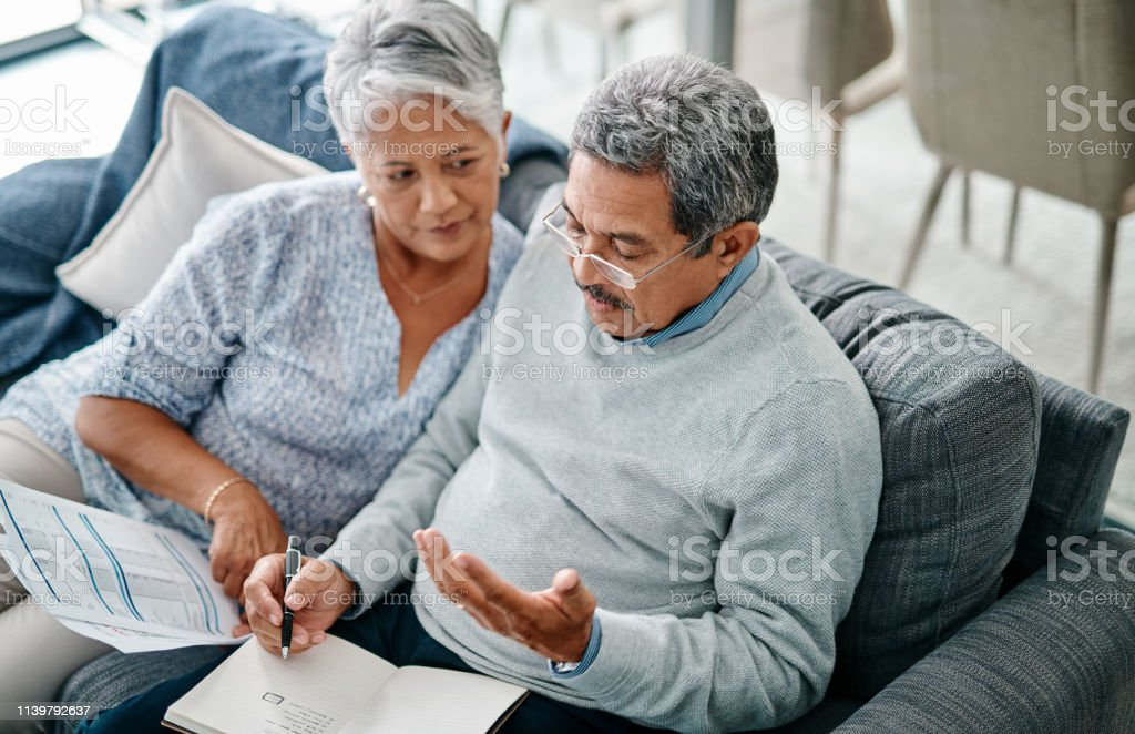 Adding the numbers as he goes stock photo