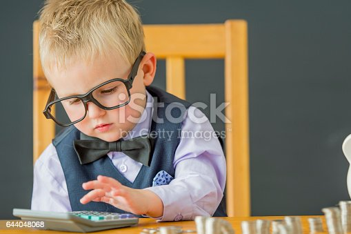 istock Adding Up His Coins 644048068