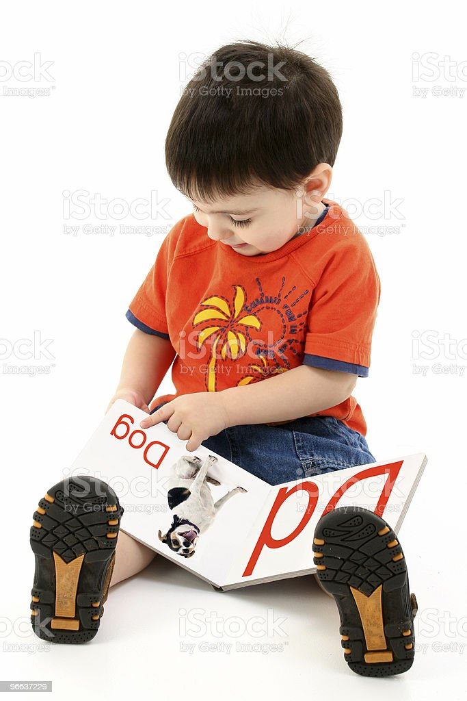 Addorable Toddler Boy Reading Alphabet Book stock photo