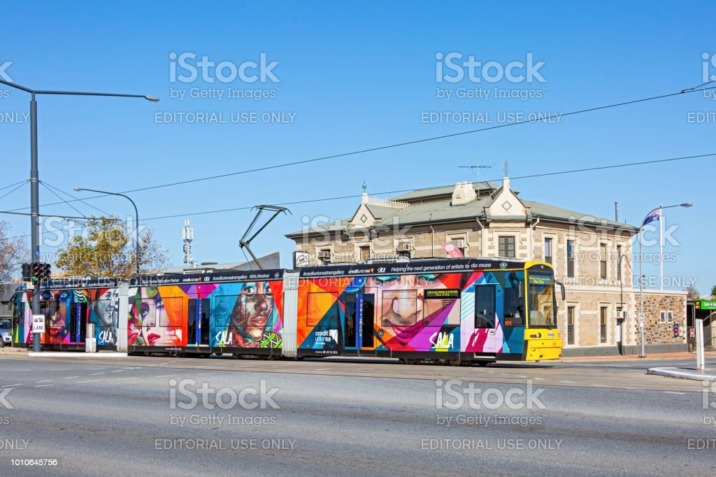 Adelaide tram adorned with Street Art images advertising the SALA...