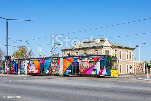 istock Adelaide tram adorned with Street Art images advertising the SALA Festival, passing historic hotel 1010645756