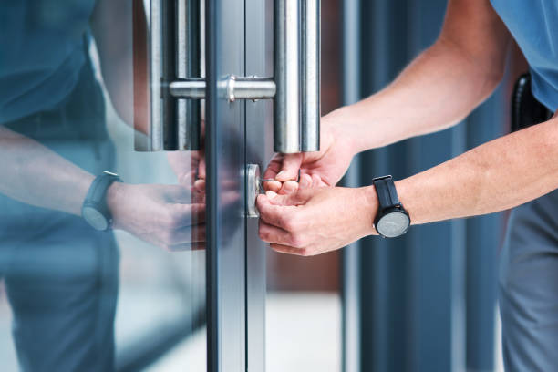 Adequate security is important in every aspect of life Shot of an unrecognizable male locksmith installing a lock locksmith stock pictures, royalty-free photos & images