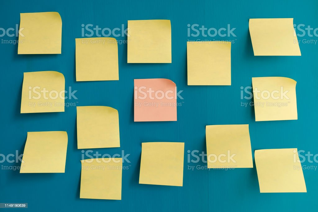 Adhesive notes on blue background