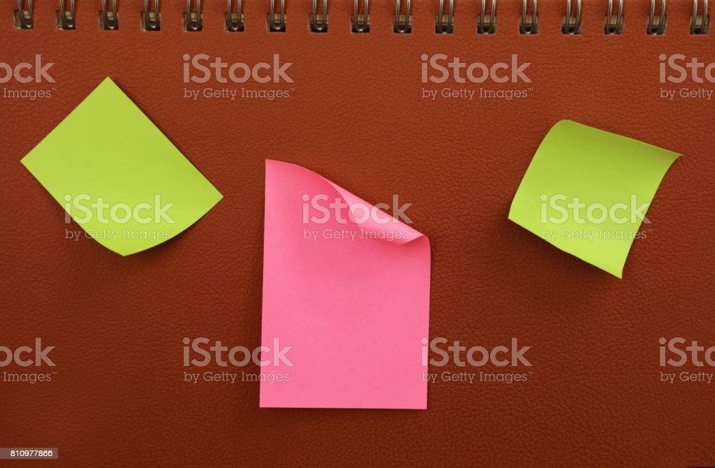 Adhesive Notes on Leather Background stock photo