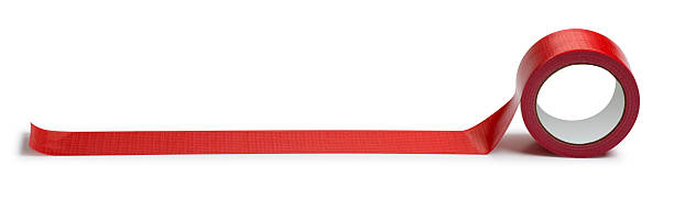 Adhesive Red Tape Isolated on White This is a photo taken in the studio of a roll of red duct tape isolated on a white background. There is a clipping path included with this file. bureaucracy stock pictures, royalty-free photos & images