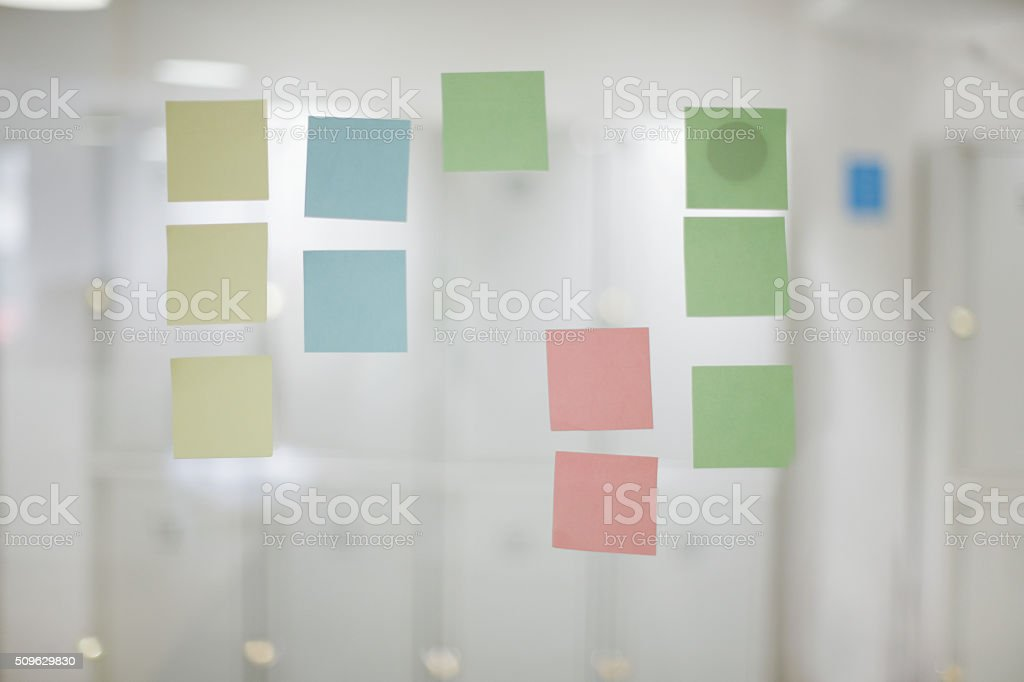 Adhesive reminders in office stock photo