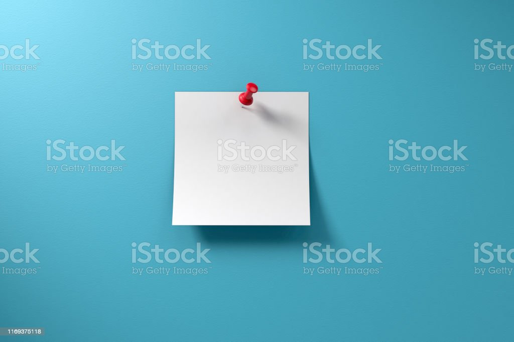 Blank adhesive sticky note and red thumbtack on a blue background...