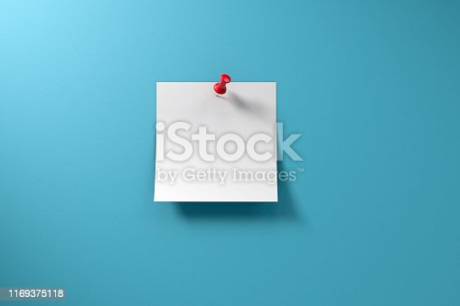 Blank adhesive sticky note and red thumbtack on a blue background with copy space.