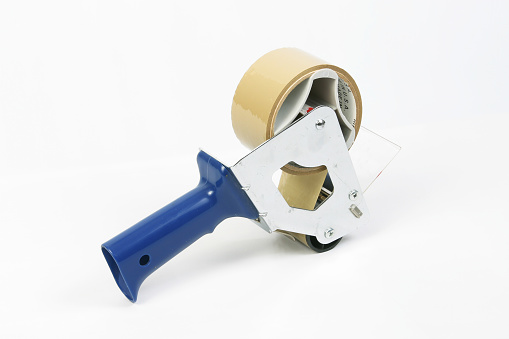 Tape Gun. Tape Dispenser for sealing shipping boxes.