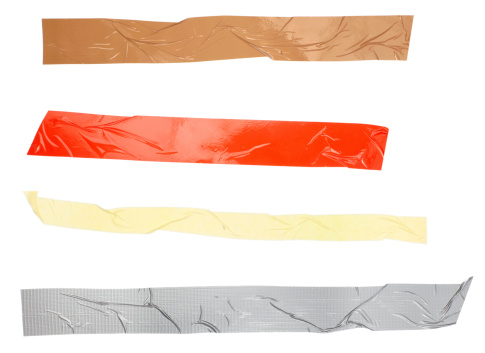 close up of an adhesive tape on white background. each one is in full camera resolutionclose up of an adhesive tape on white background with clipping path
