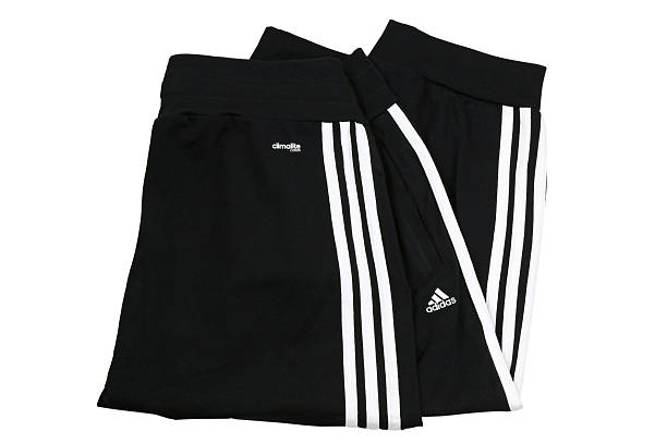 Adidas ClimaLite cotton cuffed workout pants for woman stock photo