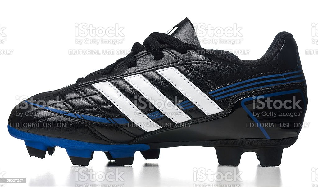 Adidas Puntero soccer kid shoe stock photo
