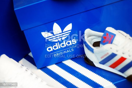 Liverpool, England - February 26, 2011: Adidas shoes in store window. Adidas AG is a German sports apparel manufacturer and parent company of the Adidas Group.