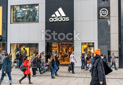Frankfurt, Germany - Pedestrians passing an entrance to a large Adidas store in Frankfurt.