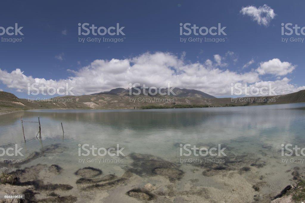 Adilcevaz village, mountain reflection of the lake stock photo