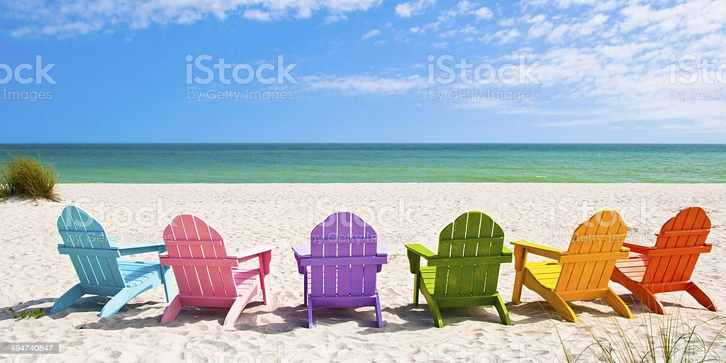 Adirondack Beach Chairs on a Sunny Vacation Beach stock photo