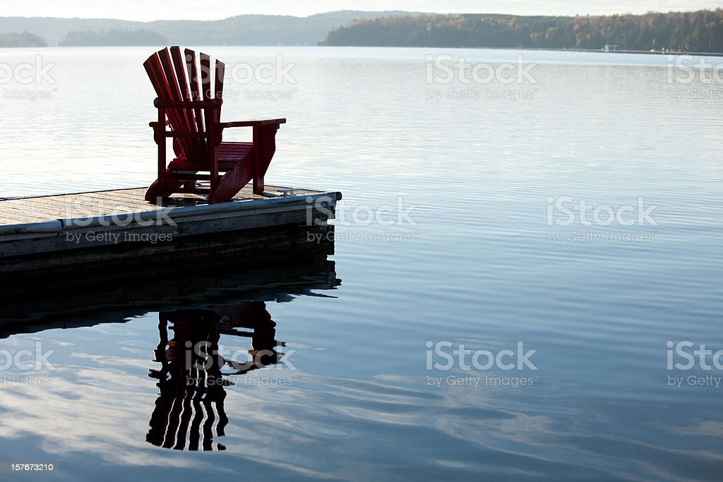 Adirondack Chair by a Lake stock photo