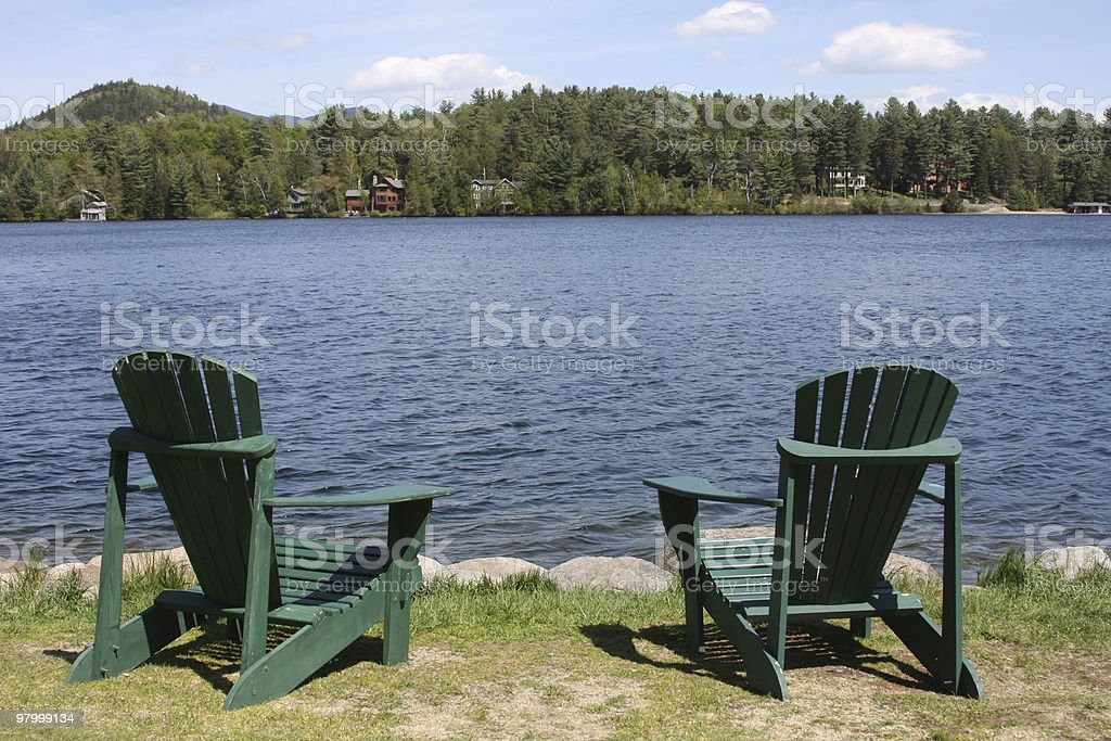 adirondack chair by lakeside royalty-free stock photo