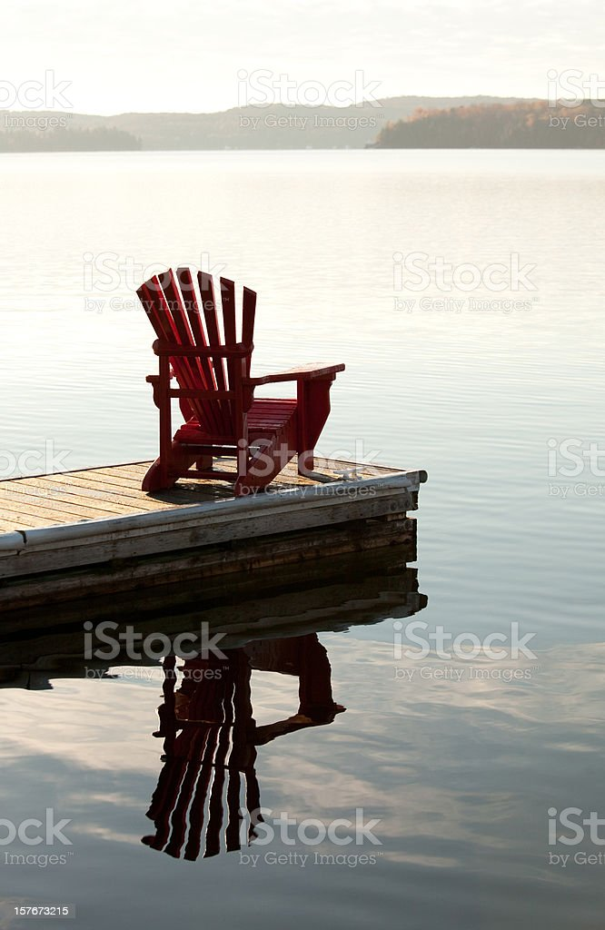 Adirondack Chair by the Lake royalty-free stock photo
