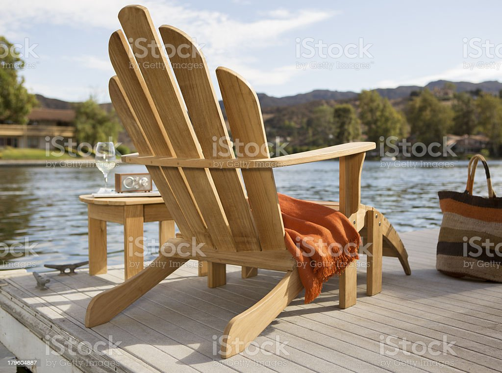 Adirondack chair on the lake stock photo