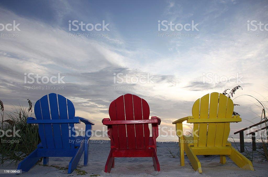 Adirondack Chairs at Beach Sunset stock photo