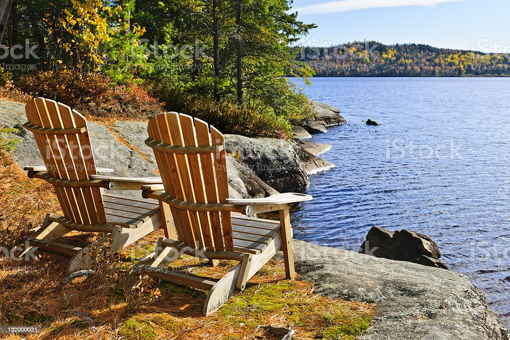 Adirondack chairs at lake shore royalty-free stock photo