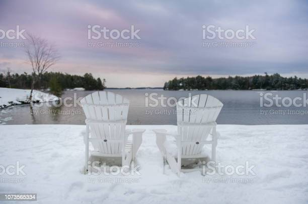 Photo of Adirondack chairs in a winter landscape