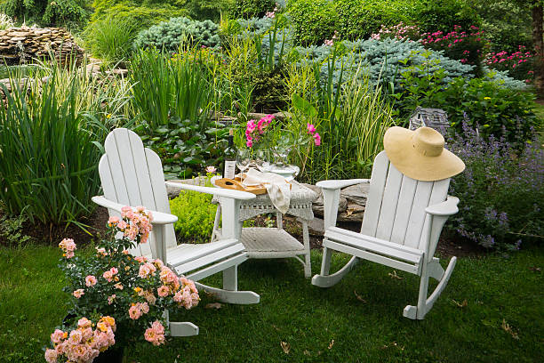 Adirondack chairs in the garden stock photo