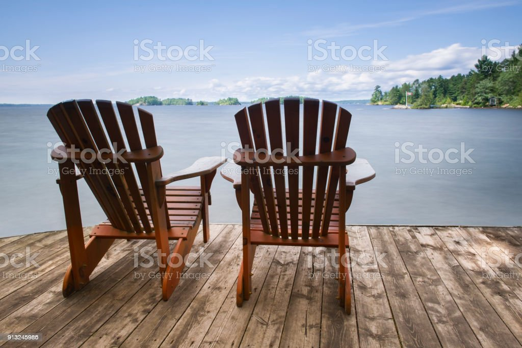 Adirondack Chairs On A Wood Dock In Canada Royalty Free Stock Photo
