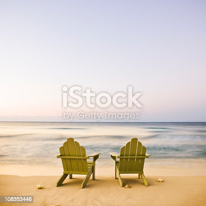 istock Adirondack Chairs on Beach 108353446