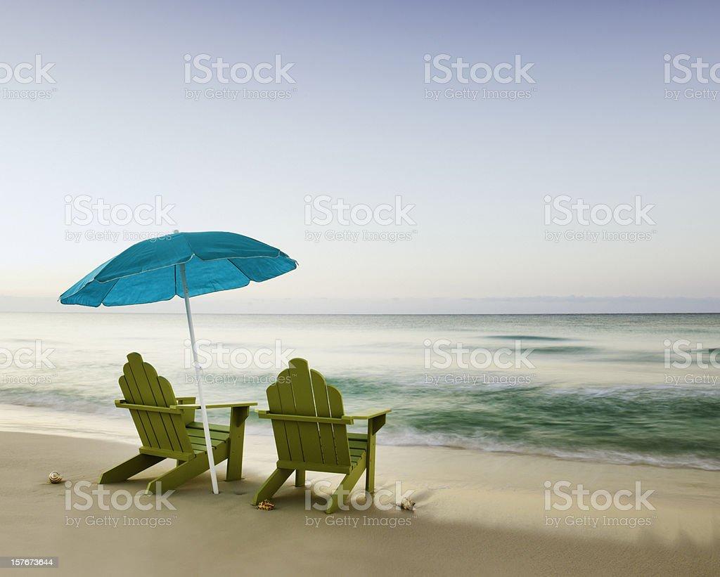 Adirondack Chairs on Beach with Unbrella stock photo