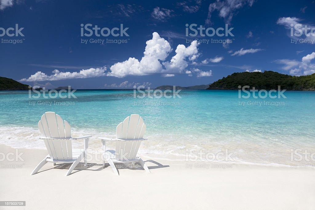 adirondack chairs on the beach stock photo