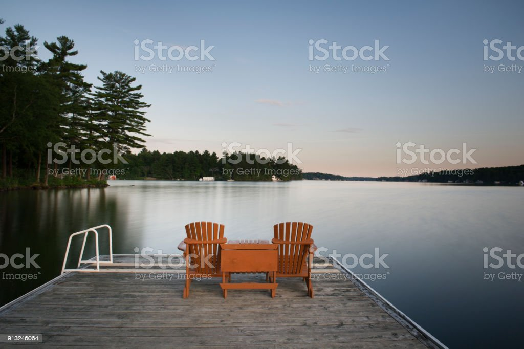 Adirondack Chairs On Wooden Dock Royalty Free Stock Photo