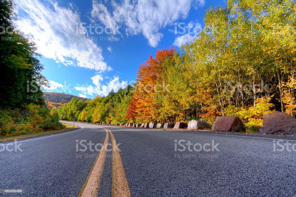 Adirondack Mountain Road and Trees in Autumn stock photo