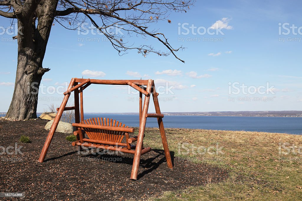 Adirondack Wooden Love Seat - Peaceful Swing royalty-free stock photo