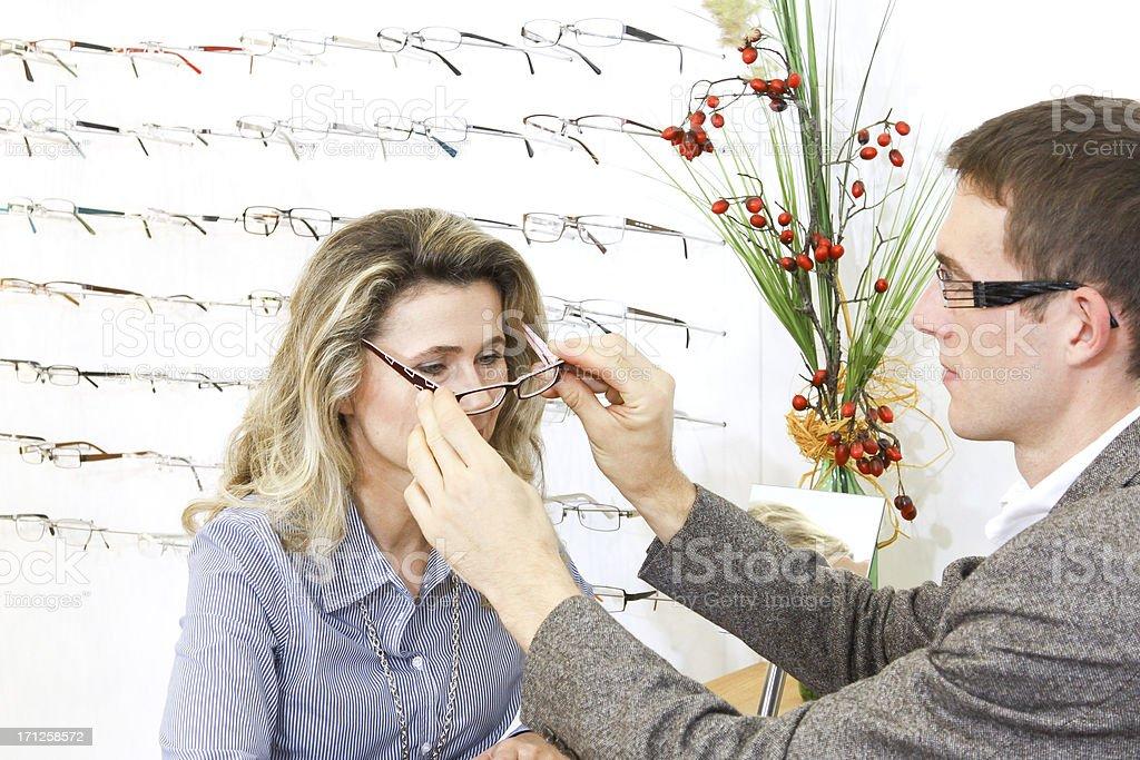 adjust new eyeglasses royalty-free stock photo