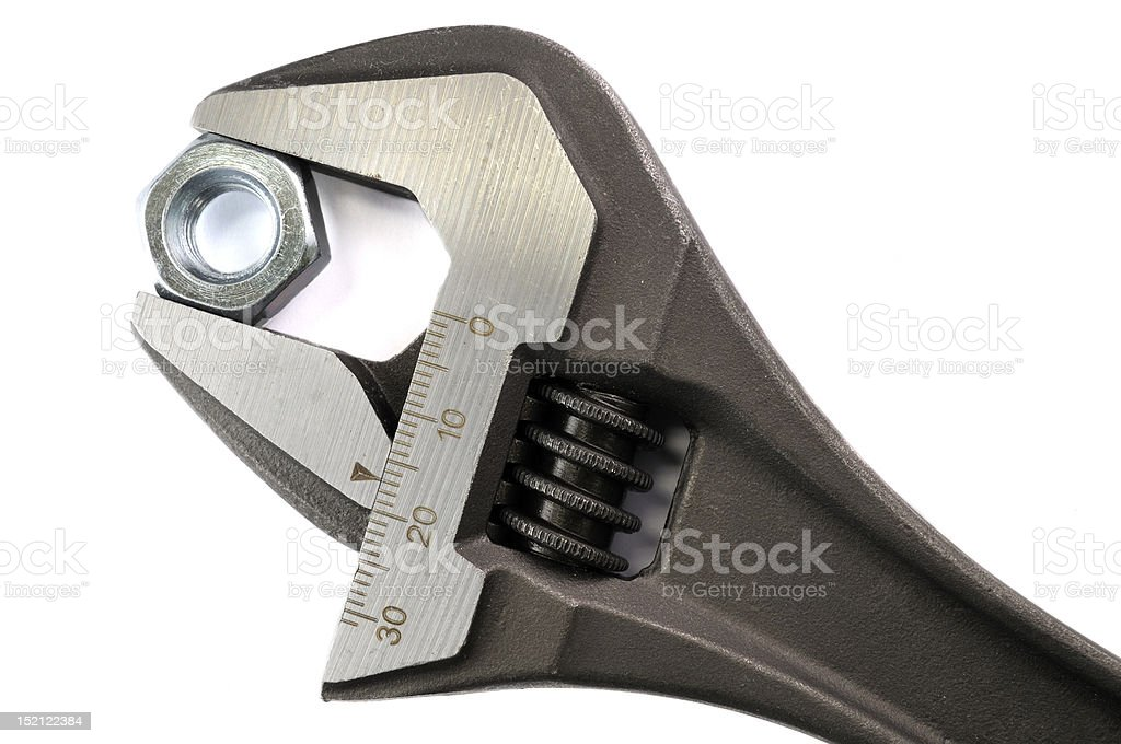 Adjustable spanner and nut royalty-free stock photo