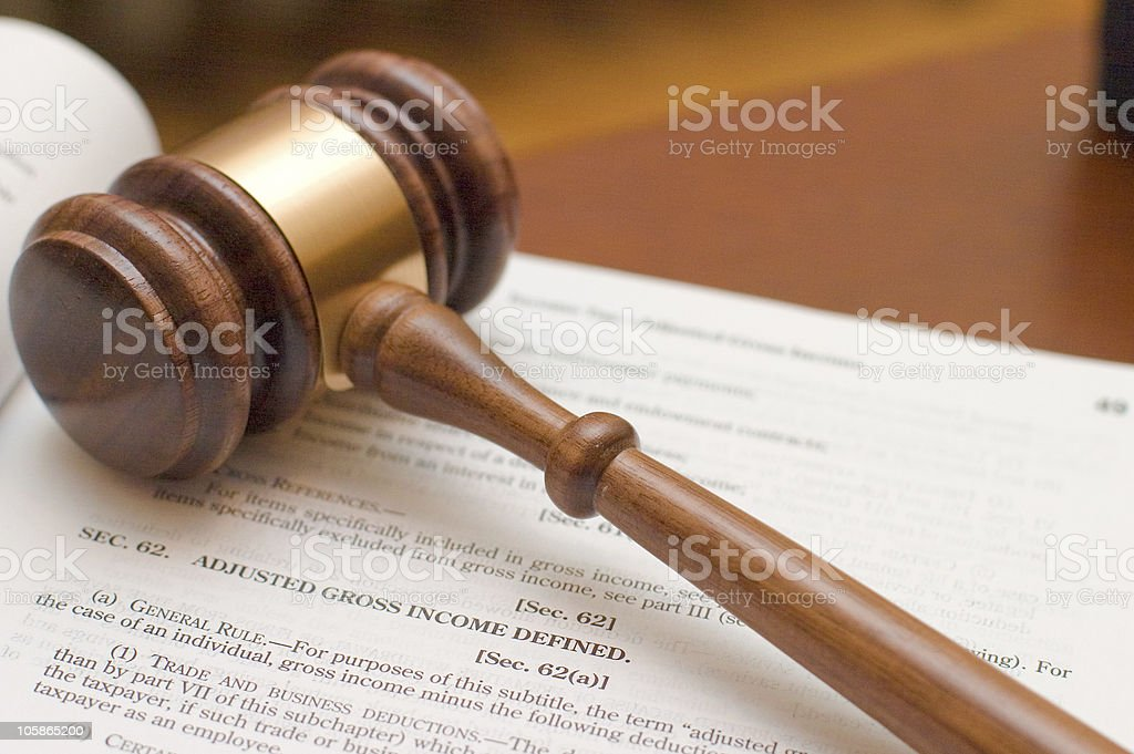 Adjusted Gross Income Gavel on Internal Revenue Code, section that defines Adjusted Gross Income. Book Stock Photo