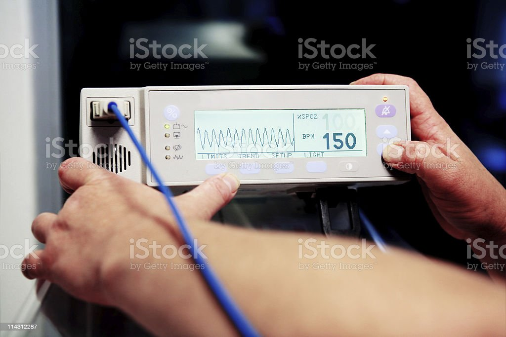Adjusting baby heart monitor royalty-free stock photo