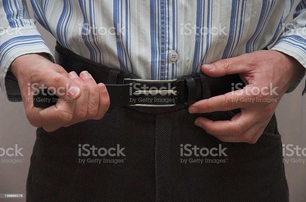 Adjusting Belt royalty-free stock photo